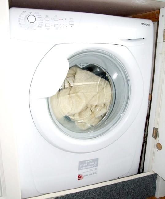 Як відкрити кришку пральної машини